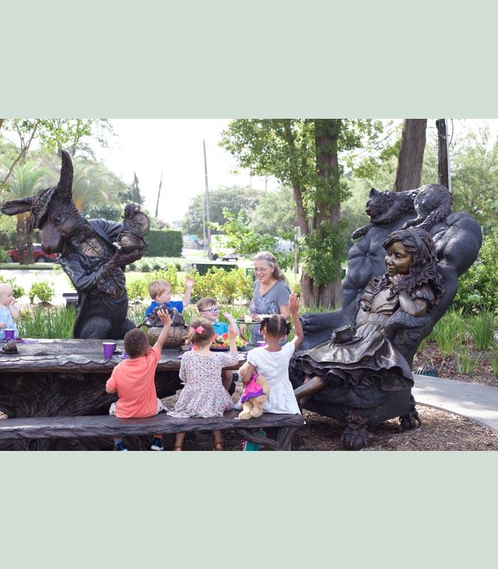 Texas sculptor Bridgette MOngeon with Alice in Wonderland in Evelyn's Park.