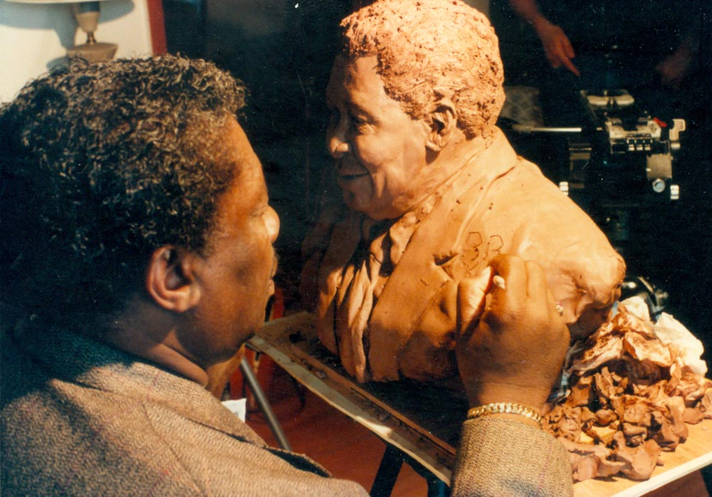 B. B. King signs the statue that Houston Texas artist created
