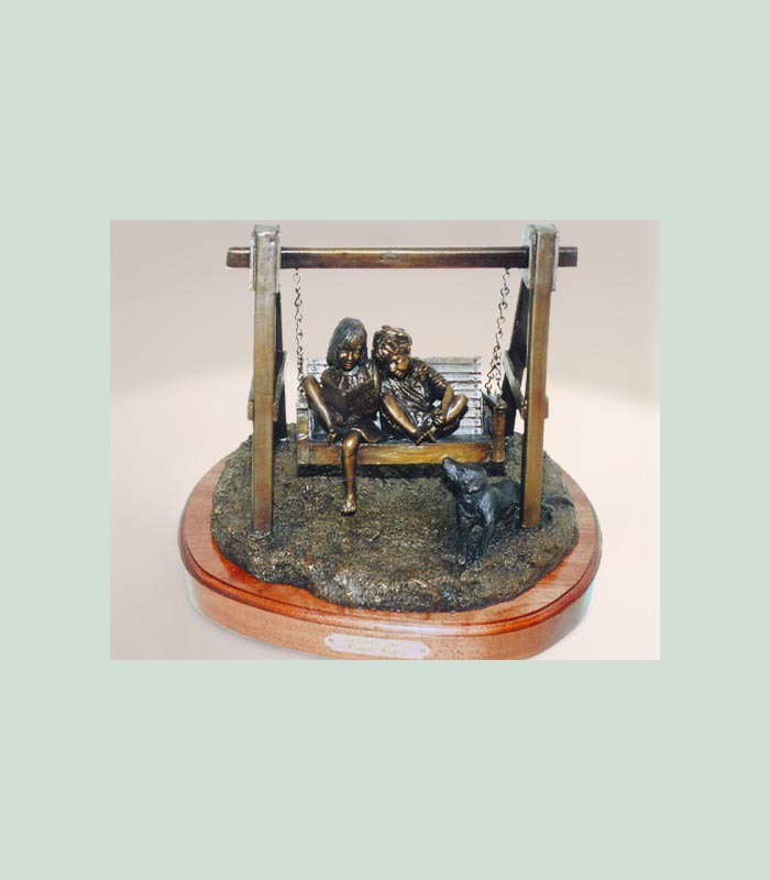 bronze sculpture of two children in a swing