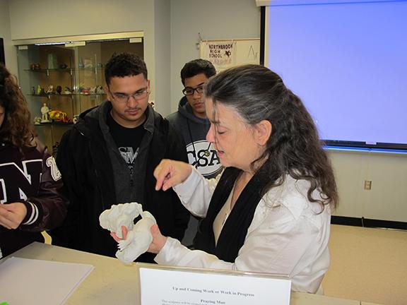 Artist Bridgette Mongeon discusses with students.