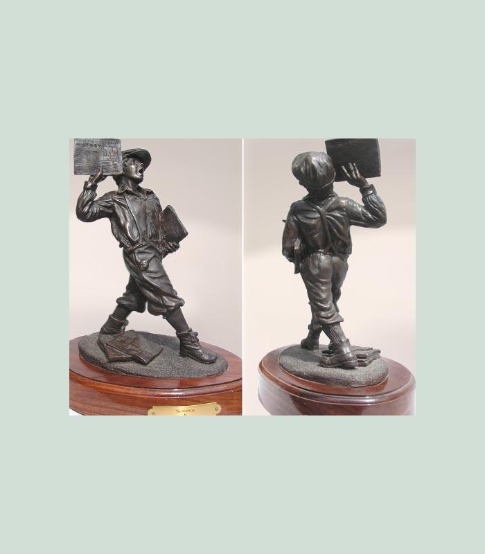 bronze newsboy statue