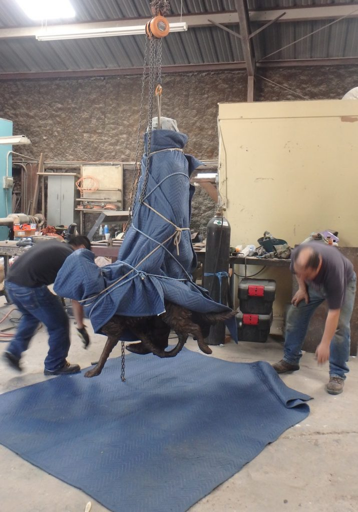 Installation of a bronze sculpture