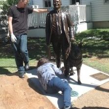 Installing a bronze sculpture of a man and dog. Texas artist Bridgette Mongeon.